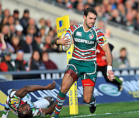 Leicester, England. Niall Morris of Leicester Tigers races away from Ugo Monye of Harlequins during the Aviva Premiership match between Leicester Tigers and Harlequins at Welford Road on September 22, 2012 in Leicester, England.