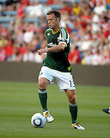 Portland midfielder Jack Jewsbury (13) makes a move with the ball.  The Portland Timbers defeated the Chicago Fire 1-0 at Toyota Park in Bridgeview, IL on July 16, 2011.