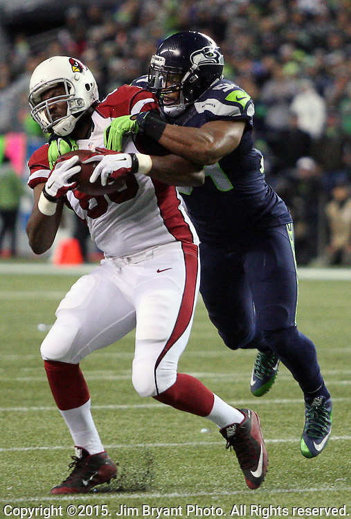 Seattle Seahawks  linebacker Bruce Ivin (51) wraps up Arizona Cardinals tight end Darren Fells (85) after catching a short pass from Palmer at CenturyLink Field in Seattle, Washington on November 15, 2015. The Cardinals beat the Seahawks 39-32.   ©2015. Jim Bryant photo. All Rights Reserved.