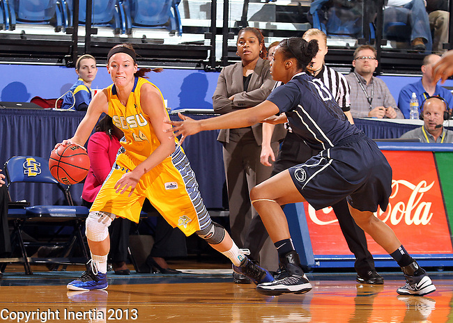 BROOKINGS, SD - DECEMBER 11:  Megan Waytashek #24 from South Dakota State University looks to drive against Ariel Edwards #23 from Penn State in the first half of their game Wednesday night at Frost Arena in Brookings. (Photo by Dave Eggen/Inertia)