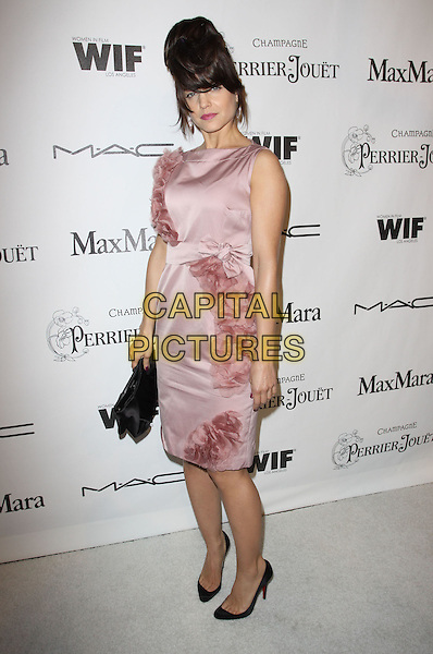 MENA SUVARI.3rd Annual Women In Film Pre-Oscar Party held At A Private Residence, Bel Air, California, USA..March 4th, 2010.full length sleeveless dress pink hair fringe up silk chiffon ruffle ruffles black clutch bag shoes  .CAP/ADM/KB.©Kevan Brooks/AdMedia/Capital Pictures.