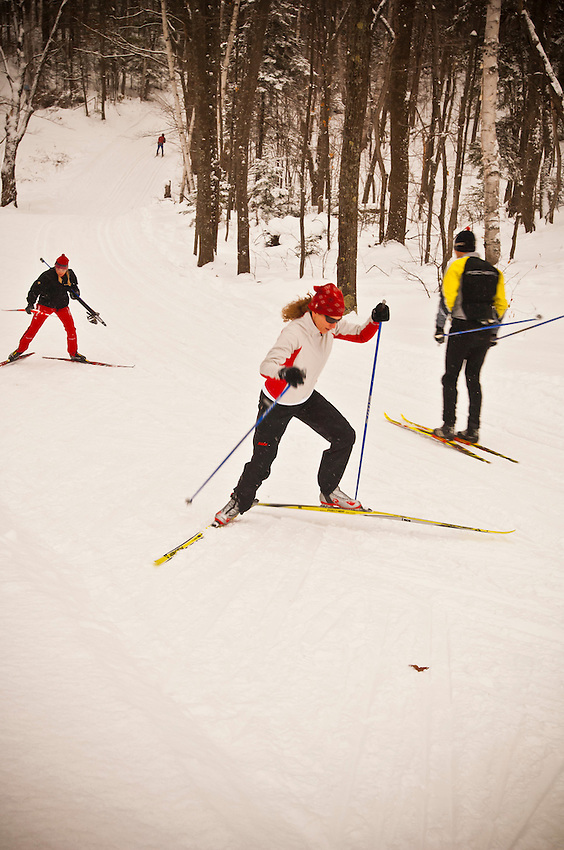 Nordic cross country skiers warm up on the trails of the Al Quaal Recreation Area in Ishpeming Michigan prior to the Noquemanon Ski Marathon.