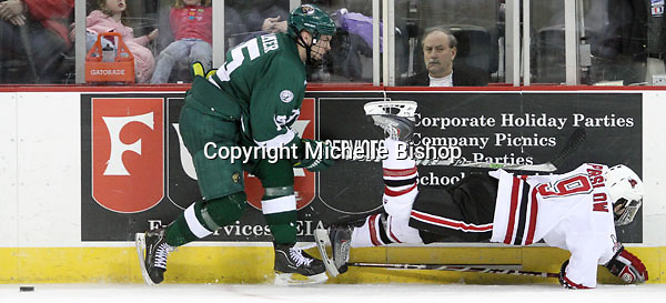 Bemidji State's Ryan Cramer watches as UNO's Rich Purslow gets tripped up during the third period. Bemidji State beat UNO 4-2 Friday night during the first round of the WCHA playoffs at Qwest Center Omaha. (Photo by Michelle Bishop)