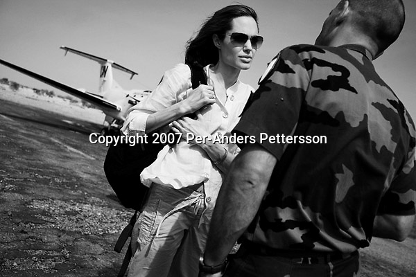 BAHAI, CHAD FEBRUARY 26: Angelina Jolie, the Oscar winning actress and UNHCR Goodwill Ambassador talks to a French soldier in Abeche, after arriving on a plane. Angelina Jolie spent two days visiting Oure Cassoni, a refugee camp close to the Sudan border. Almost 27,000 refugees lives there and it was opened in 2004. .(Photo by Per-Anders Pettersson/Getty Images).