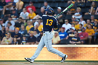 Jackson Cramer (13) of the West Virginia Mountaineers follows through on a home run in the first inning against the Wake Forest Demon Deacons in Game Four of the Winston-Salem Regional in the 2017 College World Series at David F. Couch Ballpark on June 3, 2017 in Winston-Salem, North Carolina. The Demon Deacons walked-off the Mountaineers 4-3. (Brian Westerholt/Four Seam Images)