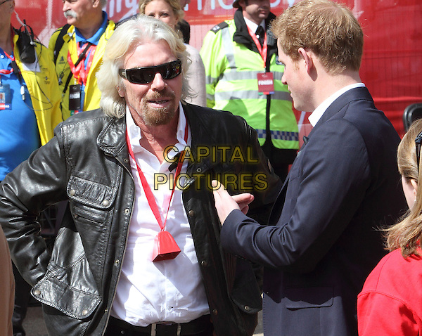 Sir Richard Branson and Prince Harry.London Marathon 2013 - Picture coverage at the start and finish plus presentations, London, England..April 21st 2013.half length white shirt black leather jacket blue suit side profile sunglasses shades goatee facial hair royal royalty .CAP/ROS.©Steve Ross/Capital Pictures