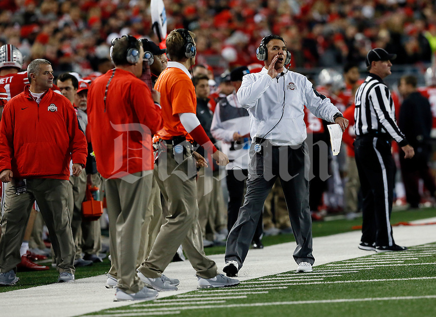 The Ohio State University head football coach Urban Meyer yells to the team during a pause in the game in the second half of their game at Ohio Stadium in Columbus, Ohio on November 7, 2015. (Columbus Dispatch photo by Brooke LaValley)
