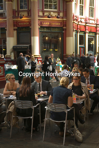 Leadenhall Market City of London EC3 UK. City office workers business men women couples lunch.