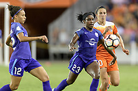 Houston, TX - Saturday June 17, 2017: Jasmyne Spencer and Carli Lloyd battle for control of the ball during a regular season National Women's Soccer League (NWSL) match between the Houston Dash and the Orlando Pride at BBVA Compass Stadium.