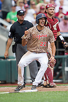 Virginia Cavaliers shortstop Daniel Pinero (22) celebrates scoring a run against the Arkansas Razorbacks in Game 1 of the NCAA College World Series on June 13, 2015 at TD Ameritrade Park in Omaha, Nebraska. Virginia defeated Arkansas 5-3. (Andrew Woolley/Four Seam Images)