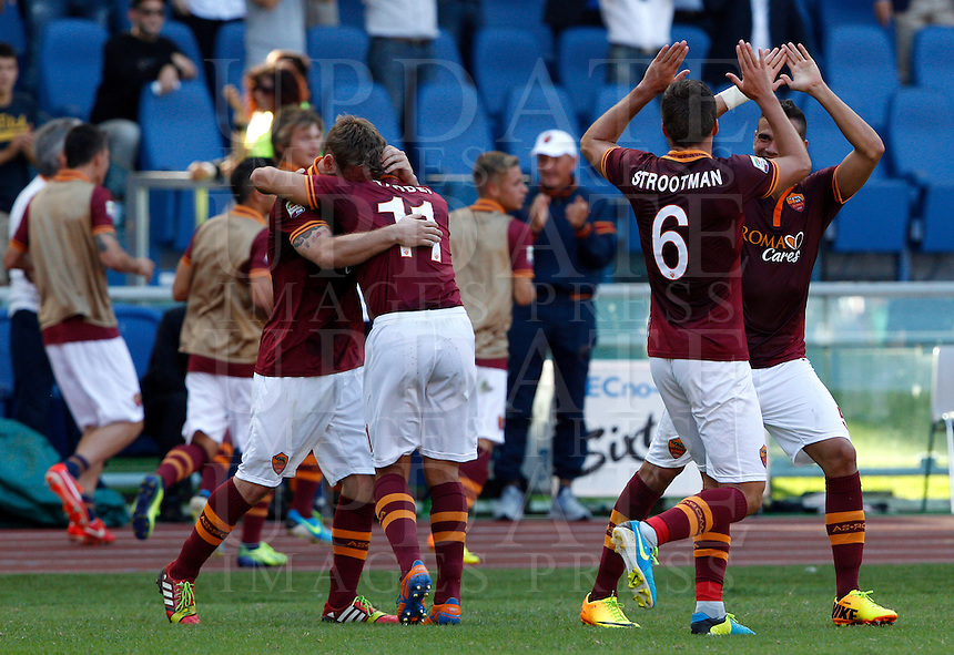 Calcio, Serie A: Roma vs Lazio. Roma, stadio Olimpico, 22 settembre 2013.<br /> From left, AS Roma's Daniele De Rossi, Rodrigo Taddei, Kevin Strootman and Leandro Castan celebrate after their teammate Adem Ljajic, not seen, scored on a penalty kick during the Italian Serie A football match between AS Roma and Lazio, at Rome's Olympic stadium, 22 September 2013. AS Roma won 2-0.<br /> UPDATE IMAGES PRESS/Riccardo De Luca