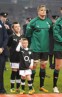 10.11.2012. Dublin, Ireland. Mascots Jack Holden and Eoin McCabe (front) stand with Ireland captain, Jamie Heaslip before the Guinness Series 2012 Rugby match between Ireland and South Africa from the Aviva Stadium