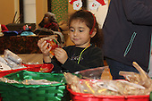 Saint Thomas the Apostle had an arts and crafts Holiday Bazaar Sunday afternoon.<br /> <br /> 9752 &ndash; Isabella Randall picked out sweet treats from Sisters&rsquo; Sweets Confections.