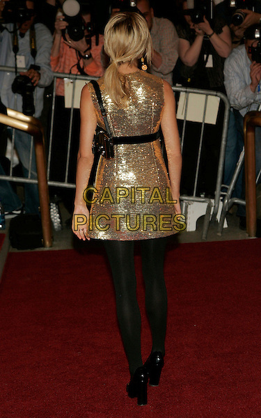 SIENNA MILLER .2006 Costume Institute Gala Celebrating British designer AngloMania held at the Metropolitan Museum of Art, New York, New York, USA..Mat 1st, 2006.Photo: Jackson Lee/AdMedia/Capital Pictures.Ref: JL/ADM.full length gold sequin dress black tights stockings back behind rear.www.capitalpictures.com.sales@capitalpictures.com.© Capital Pictures.