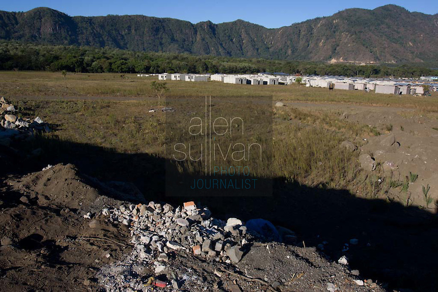A makeshift town in Tzanchaj , Guatemala on Wednesday, March 21, 2007. A deadly mudslide here was spawned by rains associated with Hurricane Stan in October 2005. Initially, up to 500 Tzujutil Maya villagers were believed to have been killed in Panabaj by the mudslide, which essentially  wiped away the town. Construction in the shelter town was halted after the area was deemed to be of high risk. Forensic anthropologists from the Fundación de Antropología Forense de Guatemala have been working to unearth the bodies of the missing and have recovered more than 100. They have also found the number of missing to be lower than originally thought, after many people were located in shelters or living in other towns after the disaster.