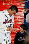 All-Star third baseman David Wright - The first Met Player immortalized in  wax -  signs a baseball for fan Brad Whitman at Madame Tussauds on 42nd Street in Times Square, New York City.<br /> April 10, 2007