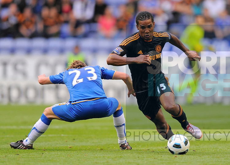 Florent Malouda of Chelsea leaves Ronnie Stam of Wigan Athletic wrong footed