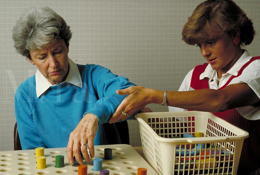 Stroke victim undergoing rehabilitation with therapist. Birmingham Alabama.