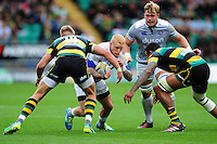 Tom Homer of Bath Rugby takes on the Northampton Saints defence. Aviva Premiership match, between Northampton Saints and Bath Rugby on September 3, 2016 at Franklin's Gardens in Northampton, England. Photo by: Patrick Khachfe / Onside Images