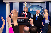 United States President Donald J. Trump delivers remakes on the COVID-19 (Coronavirus) pandemic during a Coronavirus Task Force briefing in the Brady Press Briefing Room at the White House in Washington, DC, March 18, 2020, in Washington, D.C. At right is US Vice President Mike Pence.<br /> Credit: Kevin Dietsch / Pool via CNP/AdMedia