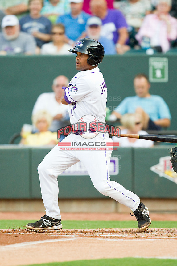 Micah Johnson (3) of the Winston-Salem Dash follows through on his swing against the Carolina Mudcats at BB&T Ballpark on July 25, 2013 in Winston-Salem, North Carolina.  The Mudcats defeated the Dash 5-4.  (Brian Westerholt/Four Seam Images)