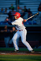 Auburn Doubledays right fielder Kameron Esthay (15) follows through on a swing during a game against the Connecticut Tigers on August 8, 2017 at Falcon Park in Auburn, New York.  Auburn defeated Connecticut 7-4.  (Mike Janes/Four Seam Images)