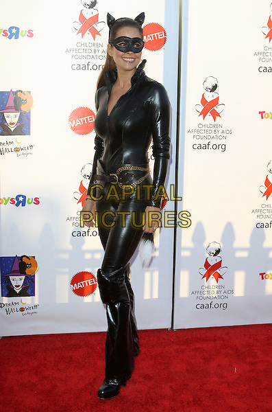 BROOKE BURKE .17th Annual Dream Halloween to benefit the Children Affected by Aids Foundation held at Barker Hanger,  Santa Monica, CA, USA, .30th October 2010..full length black cat eye mask ears catwoman costume pvc smiling outfit dressed up catsuit boots belt .CAP/ADM/KB.©Kevan Brooks/AdMedia/Capital Pictures.