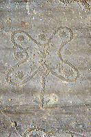 Petroglyph, rock carving, of the so called Camuni Rose, emblem of Lombardy,  named after and carved by the ancient Camunni people in the iron age between 1000-1600 BC. Rock no 24,  Foppi di Nadro, Riserva Naturale Incisioni Rupestri di Ceto, Cimbergo e Paspardo, Capo di Ponti, Valcamonica (Val Camonica), Lombardy plain, Italy