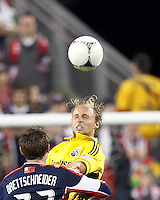 Columbus Crew substitute defender Eric Gehrig (16) heads the ball. In a Major League Soccer (MLS) match, the New England Revolution tied the Columbus Crew, 0-0, at Gillette Stadium on June 16, 2012.