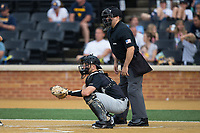 Wake Forest Demon Deacons catcher Logan Harvey (15) on defense as home plate umpire Ryan Morehead looks on during the game against the West Virginia Mountaineers in Game Six of the Winston-Salem Regional in the 2017 College World Series at David F. Couch Ballpark on June 4, 2017 in Winston-Salem, North Carolina.  The Demon Deacons defeated the Mountaineers 12-8.  (Brian Westerholt/Four Seam Images)