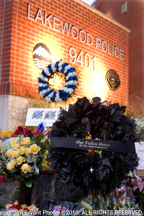 A black wreath stands nears flowers, balloons, stuff animals, pictures and  wreaths that form a makeshift memorial to four slain police officers at the Police Headquarters in Lakewood, Washington, USA, on 2 December  2009. Four Lakewood officers were gunned down during a morning meeting at a local coffee shop on 29 November 2009.  Jim Bryant Photo. ©2010. ALL RIGHTS RESERVED.
