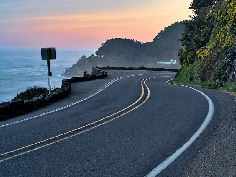 Road leading to Heceta Lighthouse at sunrise. Oregon