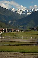 Alpine farm against snow covered mountains,Imst district, Tyrol/Tirol, Austria, Alps.