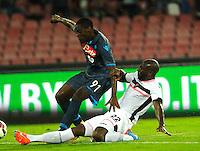 Duvan Zapata  Souleymane Bamba  durante l'incontro  di calco d Seriden A  tra SSC Napoli e US Palermo    allo stadio San Paolo di Napoli , 24 Settembre  2014