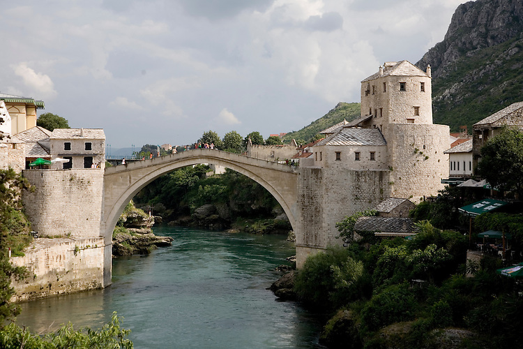 Prior to recent war, Catholic Croats, Orthodox Serbs, and Muslim Bosniaks in Mostar lived together in harmony, their differences symbolically spanned by the Mostar Bridge.