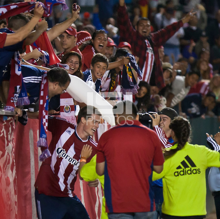 CARSON, CA – July 23, 2011: Chivas USA forward Justin Braun (17) celebrates his third goal with the fans during the match between Chivas USA and Houston Dynamo at the Home Depot Center in Carson, California. Final score Chivas USA 3, Houston Dynamo 0.