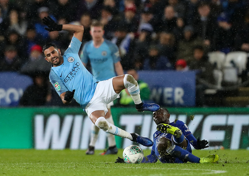 Manchester City's Riyad Mahrez is tackled by Leicester City's Wilfred Ndidi<br /> <br /> Photographer Andrew Kearns/CameraSport<br /> <br /> English League Cup - Carabao Cup Quarter Final - Leicester City v Manchester City - Tuesday 18th December 2018 - King Power Stadium - Leicester<br />  <br /> World Copyright © 2018 CameraSport. All rights reserved. 43 Linden Ave. Countesthorpe. Leicester. England. LE8 5PG - Tel: +44 (0) 116 277 4147 - admin@camerasport.com - www.camerasport.com