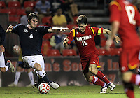 COLLEGE PARK, MD. - AUGUST 20, 2012:  Patrick Mullins (15) of  the University of Maryland goes for a loose ball against Eli Dennis (4) of Penn State during an NCAA match at Ludwig Field, in College Park, Maryland on August 20. The game ended in a 2-2 tie.