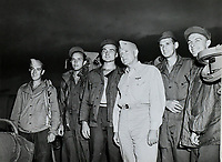 Shangri-La air group 85 prisoners of war pilot John H. Chaplin, pilot John C. Dunn, pilot Edward Dixon, pilot Richard W. Mann, and ARM (rear seat gunner) Robert F. Hanna with John H. Towers on the day or day after they were returned to the ship. — Sept. 2 or 3, 1945