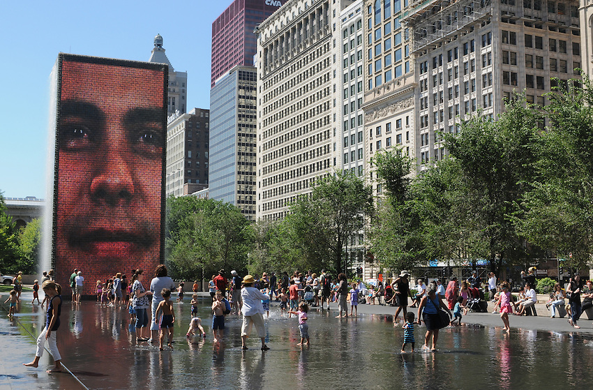 The Crown Fountain and historic building facades of South Michigan Avenue on a brilliant summer day, in Millenium Park, Chicago, Illinois.