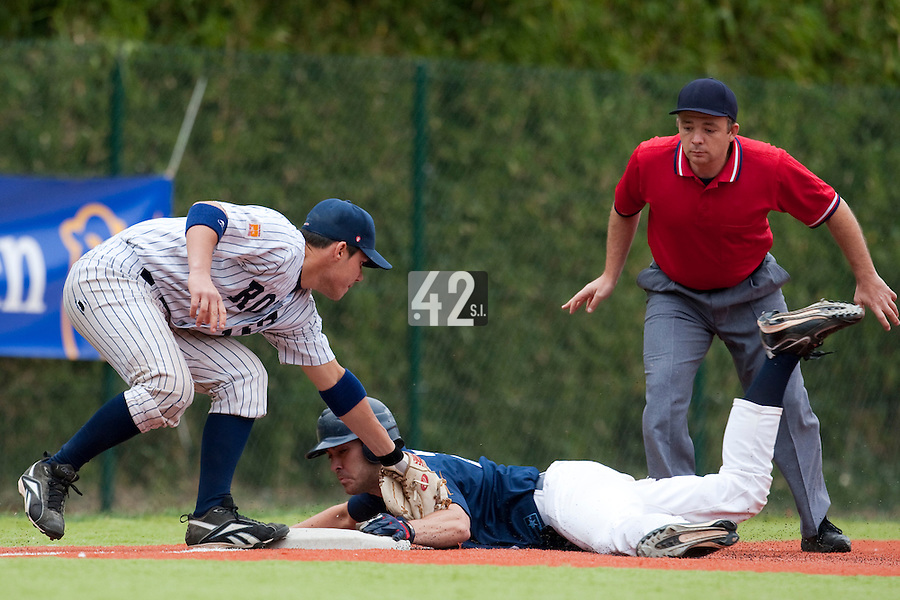 03 october 2009: Tim Stewart of Savigny is out at third base as Boris Marche tags him out while Fabien Carette-Legrand watches during game 1 of the 2009 French Elite Finals won 6-5 by Rouen over Savigny in the 11th inning, at Stade Pierre Rolland stadium in Rouen, France.