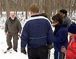 ANSONIA, CT -01 JANUARY 2006 -010106J03--- Martin Wigglesworth, left, a ranger and naturalist at the Ansonia Nature Center, leads a group of local residents through the trail at the center on Sunday as part of the center's annual Healthy New Year's Hike. among the items Wigglesworth pointed out during the hike were hawks and owls nests as well as animal tracks.  --  Jim Shannon Republican-American--  Martin Wigglesworth; Ansonia Nature Center; Healthy New Year's Hike are CQ