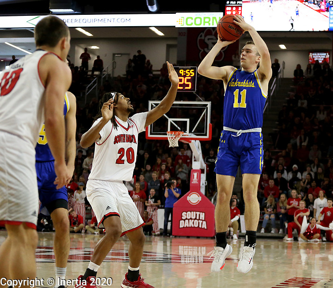 VERMILLION, SD - JANUARY 19: Noah Freidel #11 of South Dakota State Jackrabbits spots up for a jumper over Brandon Armstrong #20 of South Dakota Coyotes at the Sanford Coyote Center on January 19, 2020 in Vermillion, South Dakota. (Photo by Dave Eggen/Inertia)