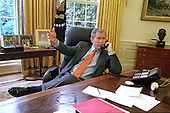 United States President George W. Bush receives a report on the phone at his desk in the Oval Office at the White House in Washington, DC from Brigadier General Neal Sealock, following Gen. Sealock's meeting with American servicemen and women in Haikou on April 6, 2001.  <br /> Mandatory Credit: Rick Wilking / White House via CNP