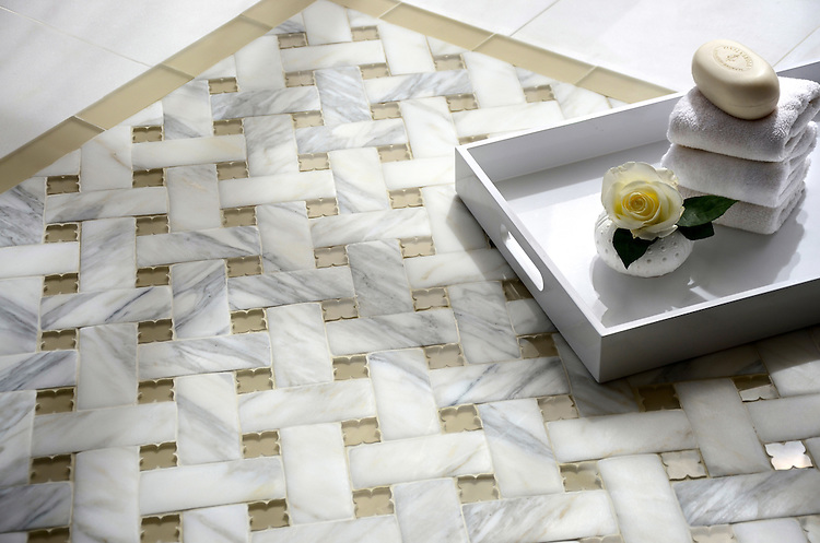 Fraser, a stone waterjet mosaic, shown in Calacatta Venetian honed and Raw Fiber Serenity glass flowers with matte Raw Fiber Serenity glass bricks, is part of the Altimetry® collection for New Ravenna.