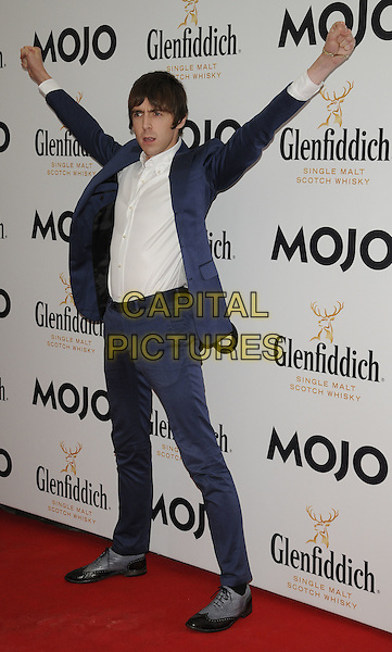 MILES KANE.The Glenfiddich MOJO Honours List award ceremony, the Brewery, Chiswell St., London, England..July 21st, 2011.full length blue suit white shirt hands arms in air fists.CAP/CAN.©Can Nguyen/Capital Pictures.