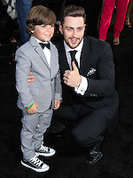 "HOLLYWOOD, LOS ANGELES, CA, USA - MAY 08: Carson Bolde, Aaron Taylor-Johnson at the Los Angeles Premiere Of Warner Bros. Pictures And Legendary Pictures' ""Godzilla"" held at Dolby Theatre on May 8, 2014 in Hollywood, Los Angeles, California, United States. (Photo by Xavier Collin/Celebrity Monitor)"