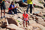 August 15, 2015 - Manitou Springs, Colorado, U.S. - Eagle, Colorado runner, Kim Dobson, negotiates the final steep pitch and rocky terrain to win the women's race in the Pikes Peak Ascent during the 60th running of the Pikes Peak Ascent and Marathon.  During the Ascent, runners cover 13.3 miles and gain more than 7815 feet (2382m) by the time they reach the 14,115ft (4302m) summit.  On the second day of race weekend, 800 marathoners will make the round trip and cover 26.6 miles of high altitude and very difficult terrain in Pike National Forest, Manitou Springs, CO.