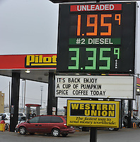 NWA Media/Michael Woods --12/19/2014-- w @NWAMICHAELW...Gas prices drop to a low of $1.95 a gallon Friday afternoon as travelers fill up their tanks at the Pilot Gas Station on Highway 412 in Springdale.