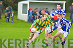 Lios Poil's Padraig O Suilleabhain gets his pass away against Templenoe's Killian Spillane in the novice championship semi-final at Firies on Sunday.